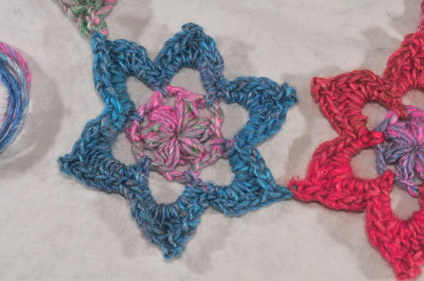 join flowers at points to create a string of colorful snowflakes