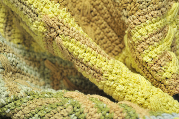 a crochet version of the popular hue shift afghan in natural-dyed cotton