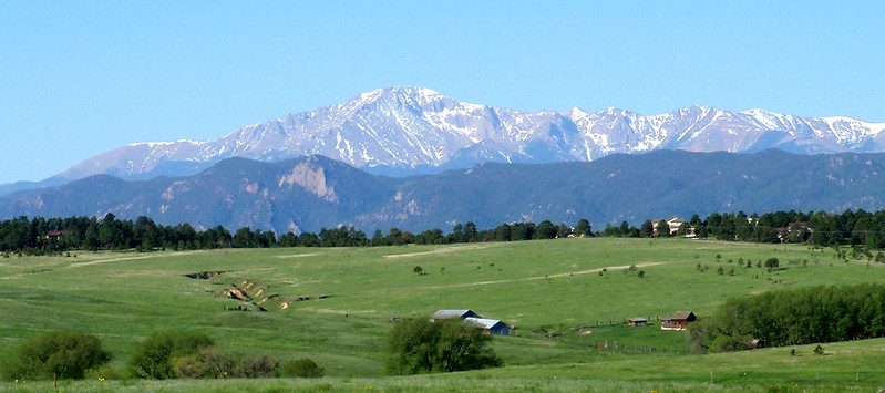 Pikes Peak rises in the morning sky.  The 14,110-foot mountain inspired Katharine Lee Bates to pen America the Beautiful.