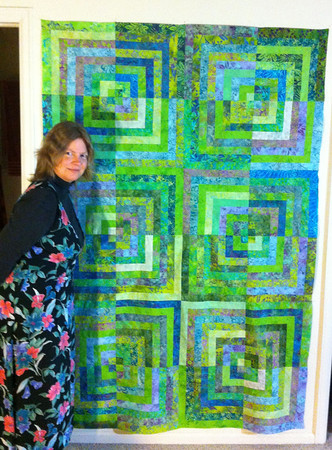 The Lizard snapped a photo of me with the quilt to show the size.