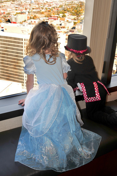 Costumed tots forgo Halloween cupcakes to enjoy the skyscraper view of Denver.